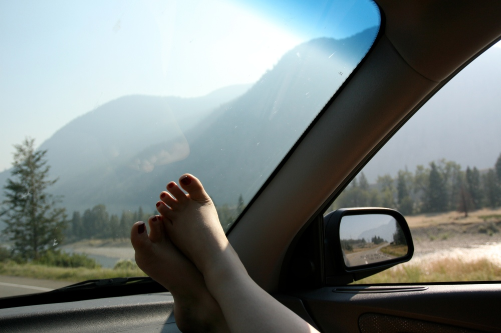 feet on a dashboard